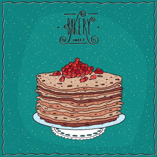 Thin pancakes with red caviar on lacy napkin Stock photo © alexanderandariadna