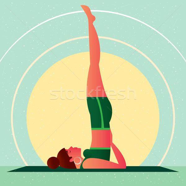 Girl in Yoga Shoulderstand Pose or Sarvangasana Stock photo © alexanderandariadna