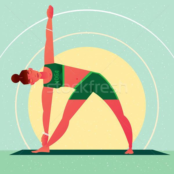 Girl in Yoga Triangle Pose or Trikonasana Stock photo © alexanderandariadna