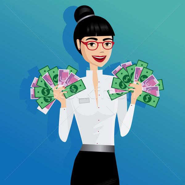 Business woman holding lot of money Stock photo © alexanderandariadna
