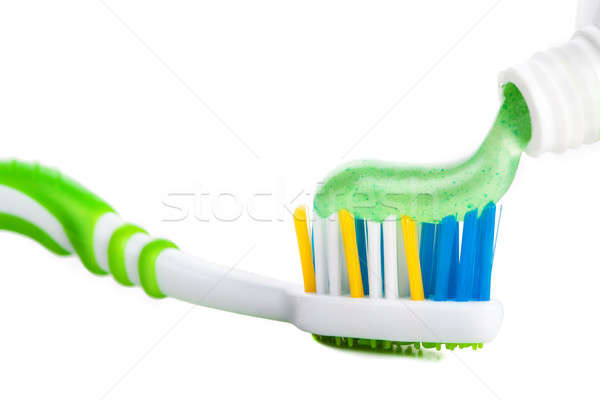 Tooth brush with tooth paste on white background Stock photo © alexandkz