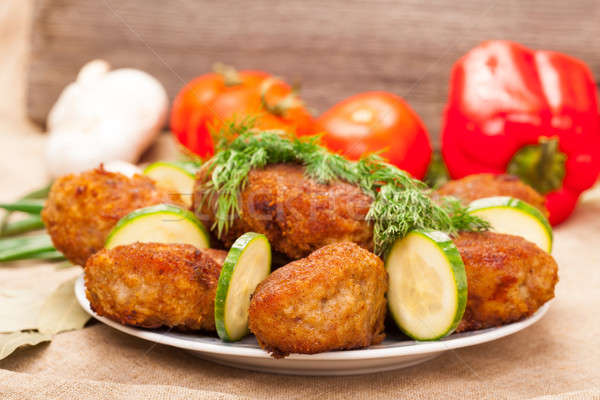 Fried cutlet with  cucumber and dill on a plate Stock photo © alexandkz