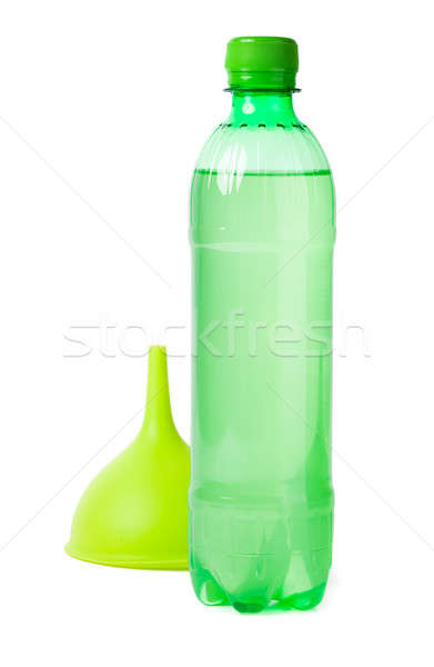Green bottle and funnel isolated on white Stock photo © alexandkz