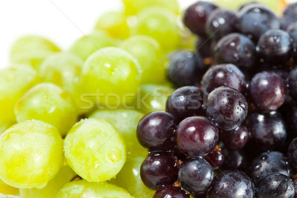 Close up shot of green and black grapes Stock photo © alexandkz
