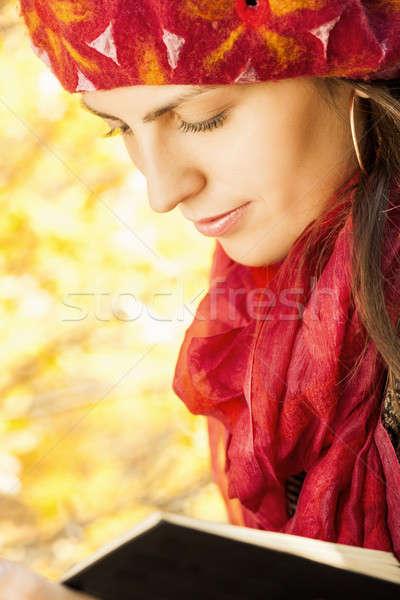 Güzel kız kitap sonbahar park çim güzellik Stok fotoğraf © alexandkz