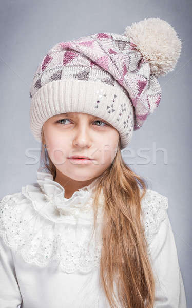 Portrait of an adorable baby girl wearing a knit pink and white winter hat.  Stock photo © alexandkz