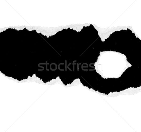 A white piece of paper is torn and the rough edges  Stock photo © alexandkz