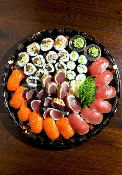 Sushi yalıtılmış plaka siyah balık pirinç Stok fotoğraf © alexandre_zveiger