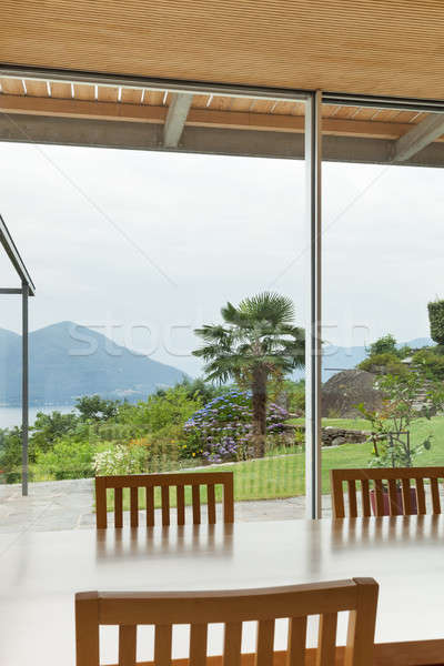 Interieur moderne huis eettafel tuin Stockfoto © alexandre_zveiger