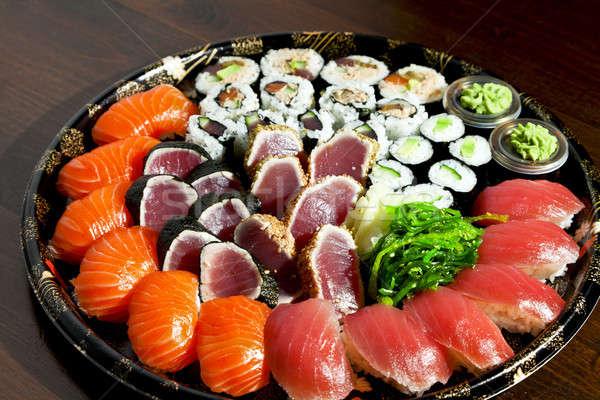 Sushis isolé plaque noir poissons riz Photo stock © alexandre_zveiger
