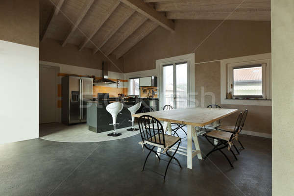 interior, new loft furnished, view of dining table and kitchen  Stock photo © alexandre_zveiger