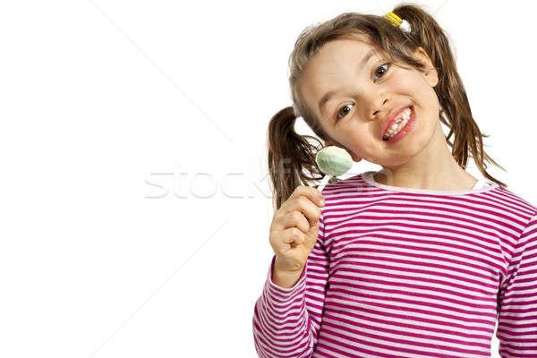 Meisje witte lolly geïsoleerd hand Stockfoto © alexandre_zveiger