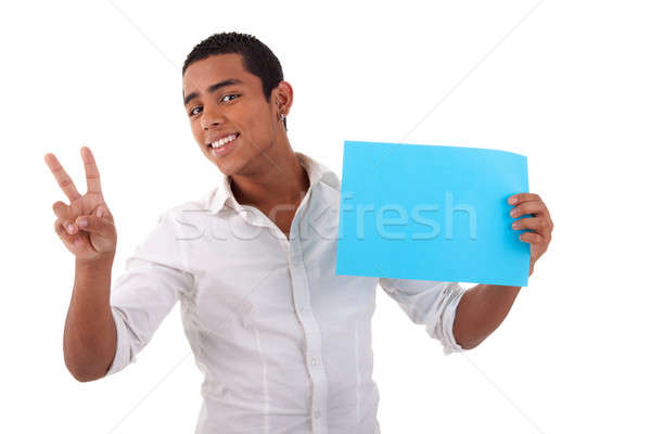 happy young latino man, with blue card in hand, fingers as sign of victory Stock photo © alexandrenunes