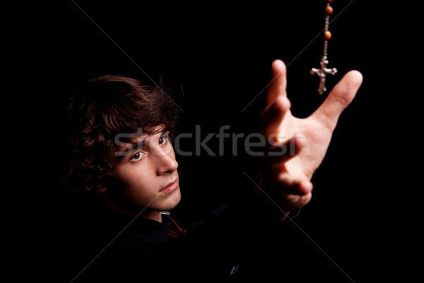 young men with arm raised, trying to grab a crucifix Stock photo © alexandrenunes