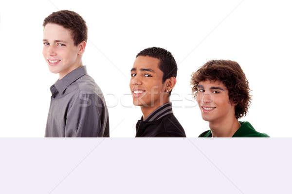 Foto stock: Três · jovem · diferente · cores · homem