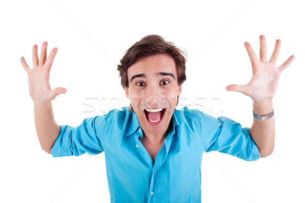 Portré boldog fiatalember karok a magasban kezek nyitva Stock fotó © alexandrenunes