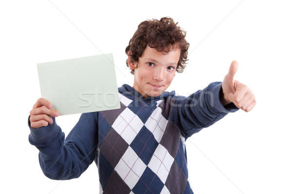 Stock photo: cute boy with a paperboard in hand giving consent, with thumb up