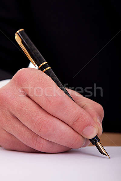 businessman signing a document with a fountain pen  Stock photo © alexandrenunes