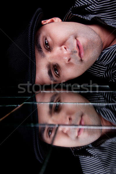 handsome man, with reflexion of the face on the mirror Stock photo © alexandrenunes