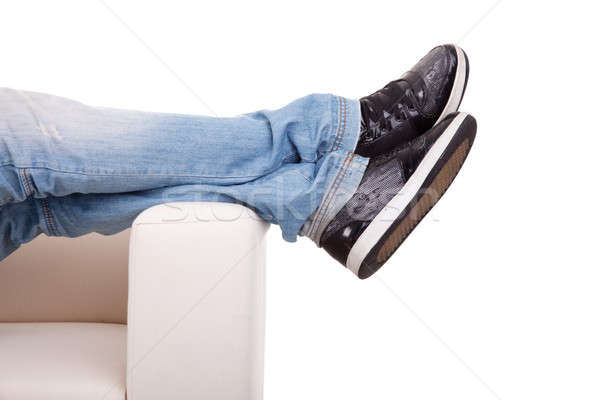 Részlet lábak nyújtott kanapé izolált fehér Stock fotó © alexandrenunes