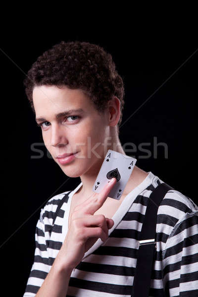 Young confident man with trouser brace, holding a ace of spades Stock photo © alexandrenunes