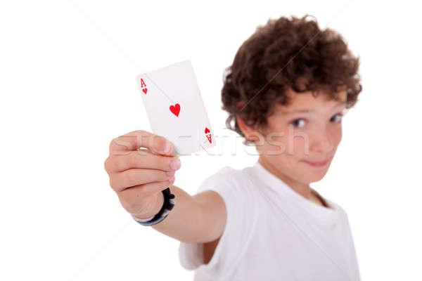 cute boy showing an ace of hearts Stock photo © alexandrenunes