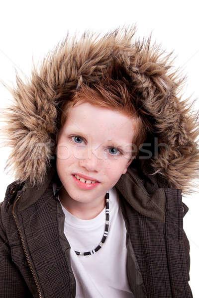 Cute boy with a furry hood Stock photo © alexandrenunes