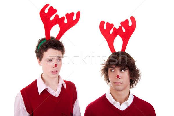 happy young men wearing reindeer horns, admired Stock photo © alexandrenunes