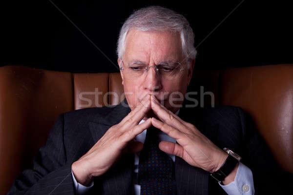 öreg üzletember ülő szék gondolkodik izolált Stock fotó © alexandrenunes