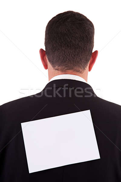 Stock photo: back of businessman, with a paper