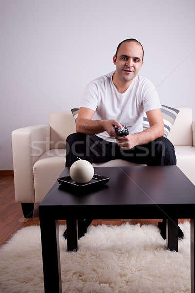 casual man watching tv on sofa Stock photo © alexandrenunes