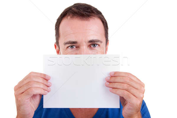 Man holding a white card in front of face, looking to camera Stock photo © alexandrenunes