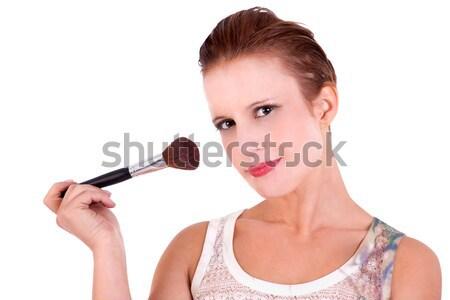 beautiful and happy middle-aged womanbeautiful and happy middle-aged with a make-up brush. Isolated  Stock photo © alexandrenunes