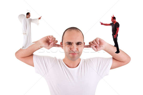 man holding fingers in his ears, not listening, discussion between the devil and angel Stock photo © alexandrenunes