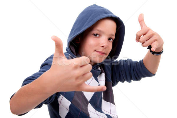 boy with his hands rise up as a sign of everything cool Stock photo © alexandrenunes