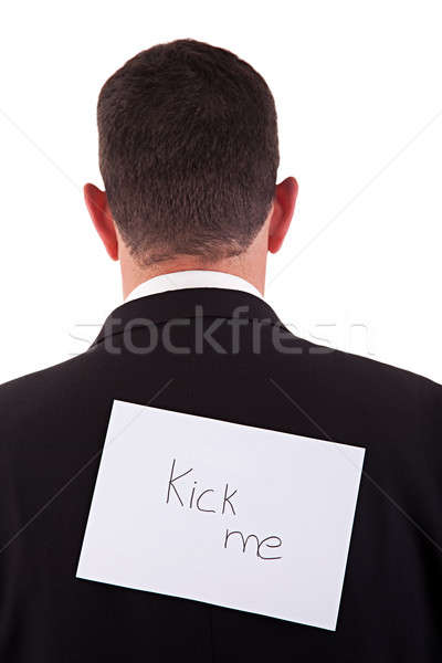 back of businessman, with kick me written in a paper Stock photo © alexandrenunes
