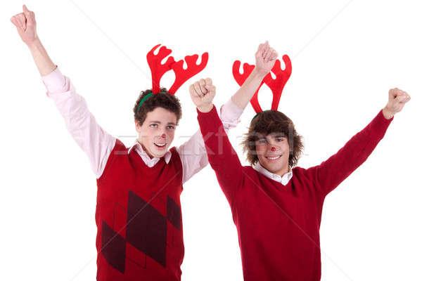 Boldog fiatal férfiak visel rénszarvas agancs karok a magasban Stock fotó © alexandrenunes