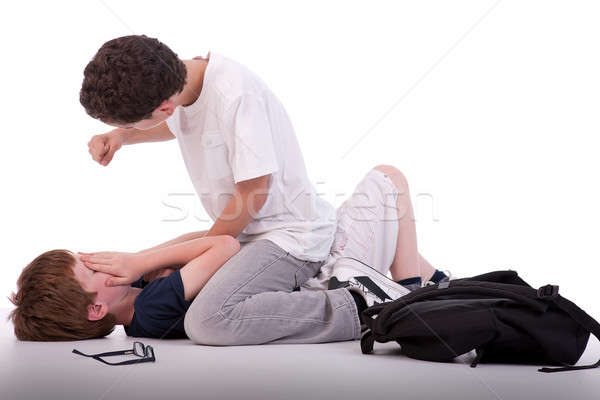 child crying on the floor child being beaten by a teenager,  Stock photo © alexandrenunes