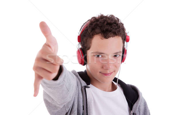 happy young man with red headphones, and thumb up,  Stock photo © alexandrenunes