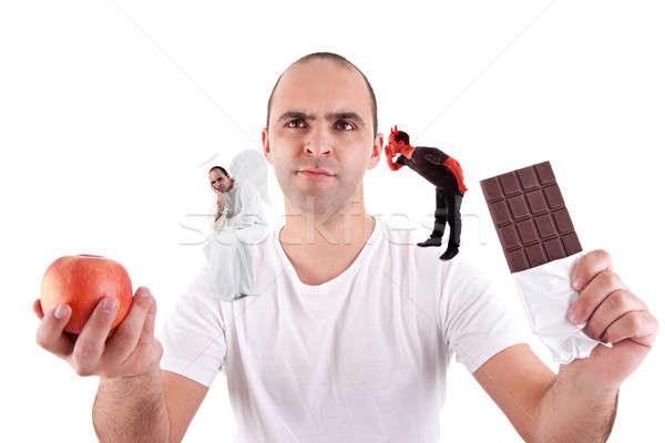 Moço rasgado alimentação maçã diabo anjo Foto stock © alexandrenunes