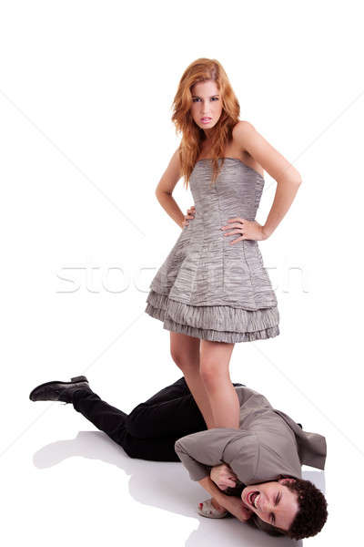 handsome young man crawling, clinging to the foot of a beautiful woman Stock photo © alexandrenunes