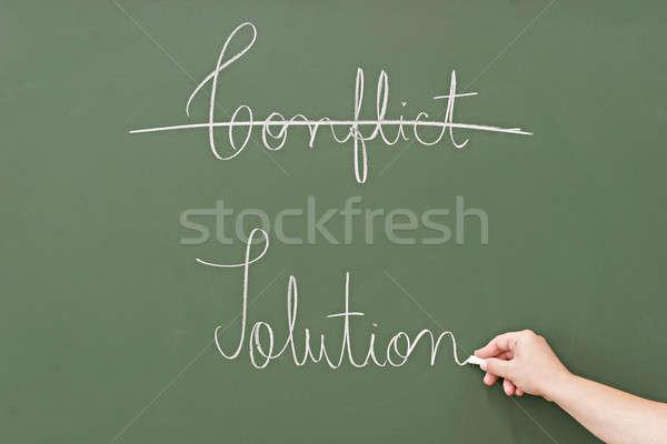 Solução conflito escrito lousa negócio escolas Foto stock © alexandrenunes