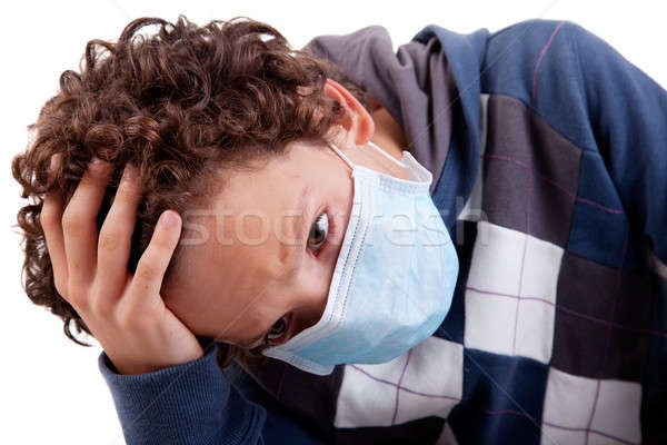 young boy with a medical mask, and the hand on head Stock photo © alexandrenunes