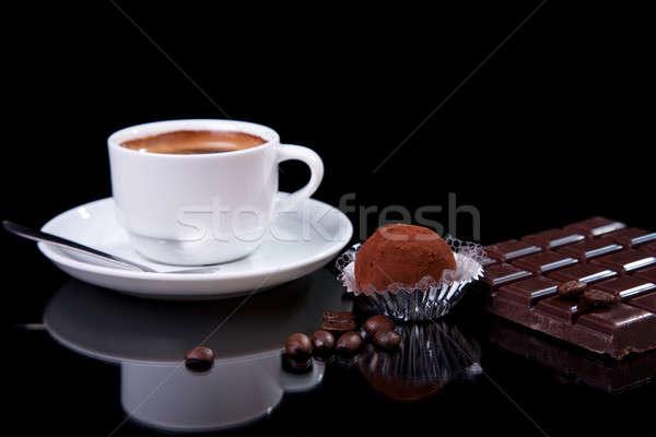 Coffee with chocolate - brigadier, on black with reflexion Stock photo © alexandrenunes