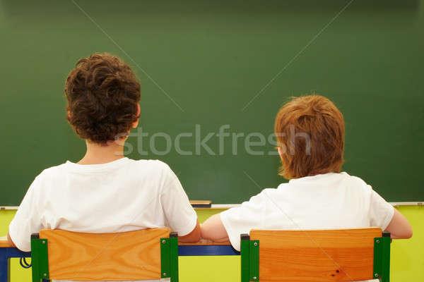 Estudantes sala de aula dois lousa criança estudante Foto stock © alexandrenunes