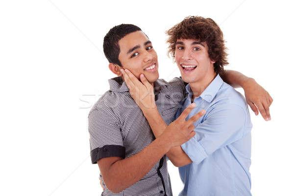 Dois jovens risonho isolado branco Foto stock © alexandrenunes