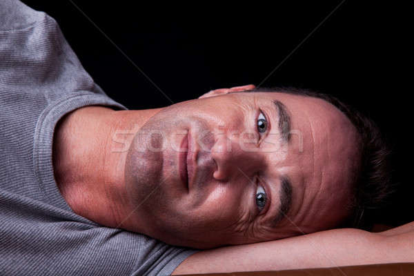 Portrait of a handsome middle-age man lying, Stock photo © alexandrenunes
