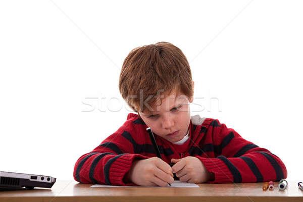 ストックフォト: 男子生徒 · 悲しい · 紙 · 顔 · 作業 · ペン