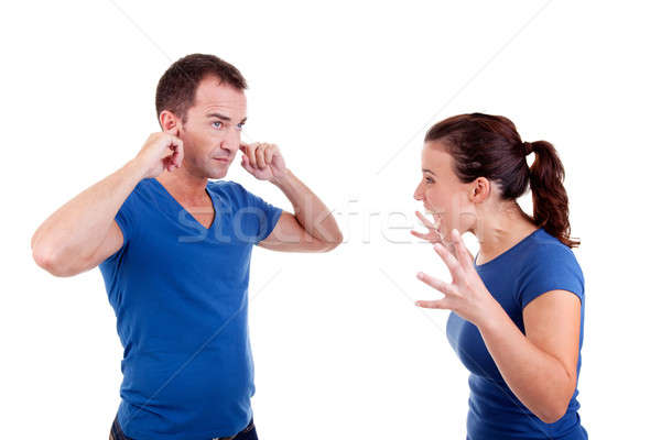 woman screaming with a man, him with hands covering his ears  Stock photo © alexandrenunes