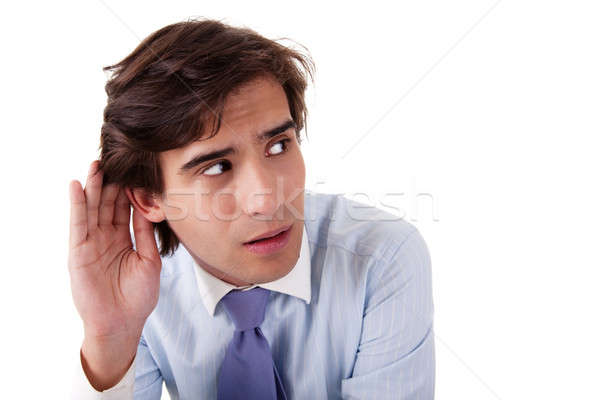 Young businessman, listening, viewing the gesture of hand behind ear Stock photo © alexandrenunes